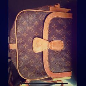 Vintage authentic Louis Vuitton sling purse